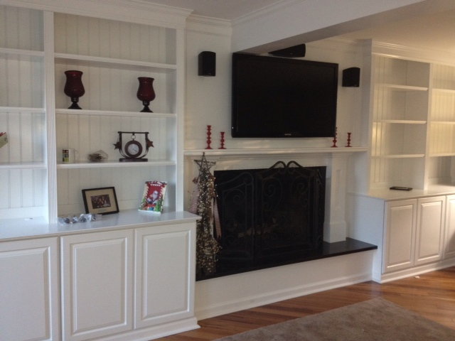 custom trimwork and painting fireplace mantels built in cabinets